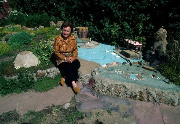 Florence Deeble sits in her rock garden in Lucas, Kansas