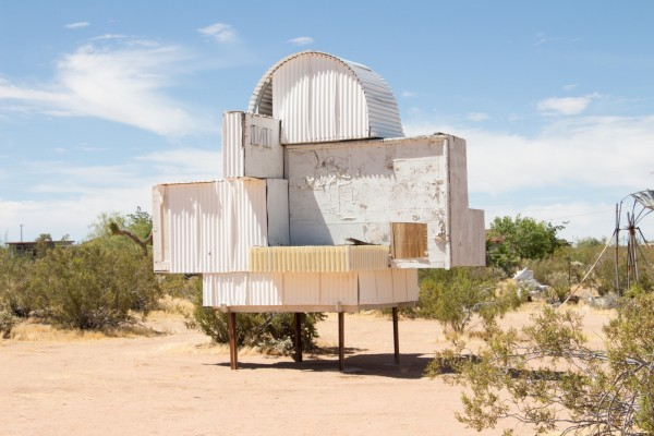 a white structure made of corrugated metal on four legs