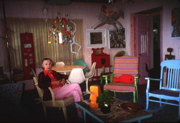 Mary Nohl sits on a chair in her home, surrounded by things she created.