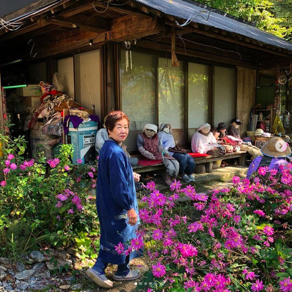 Tsukimi Ayano with some of her neighbors in Nagoro, Japan. Image courtesy of Adam H. Graham.
